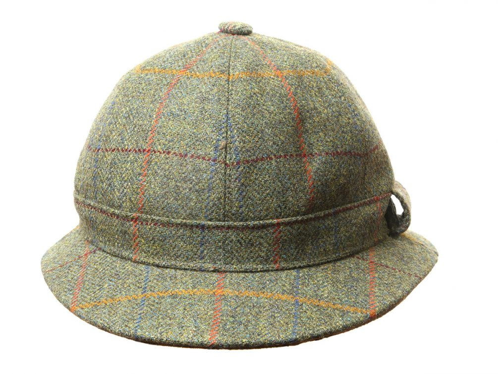 f9c8b10b626 The Stornoway Hat is the traditional Deerstalker Hat. It carries a  segmented domed crown and an all round brim.